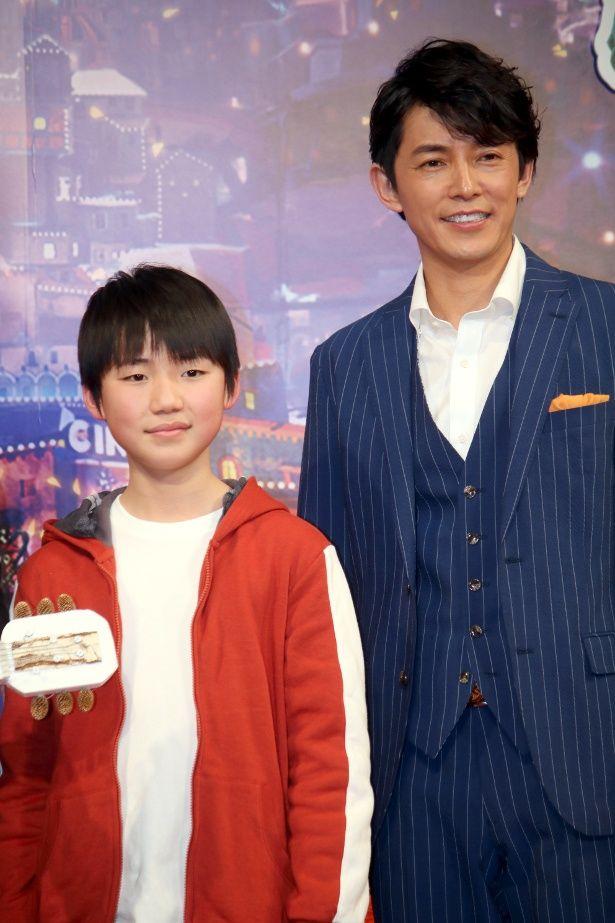 『リメンバー・ミー』の主題歌を披露した藤木直人と石橋陽彩