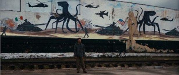壁画で描かれるような触手系モンスターが地球に来襲している世界が舞台