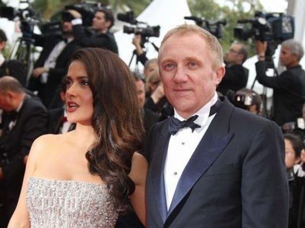 ピノー氏(右)はグッチやイヴ・サンローランなどの高級ファッションブランドを保有する大企業のCEO