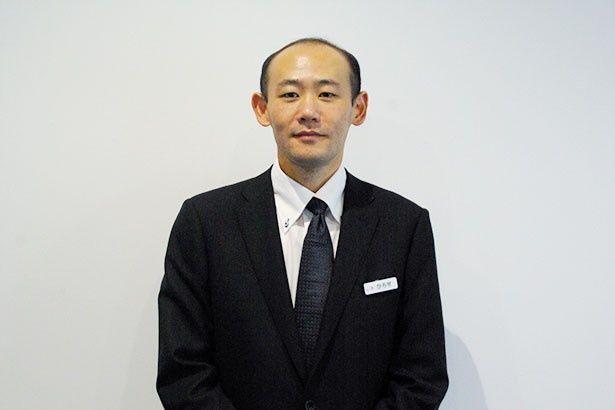 劇場支配人の廣瀬渉氏。「映画を最高の環境で楽しんでいただける先端設備を導入しています」とアピール