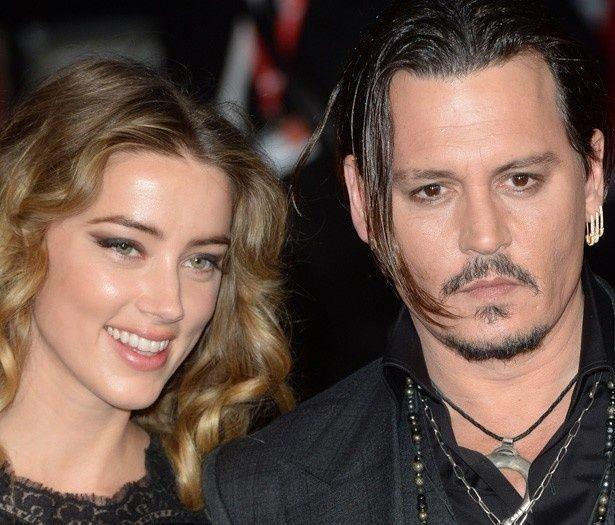 妻のアンバー・ハードと一緒にロンドン映画祭に登場したジョニー・デップ